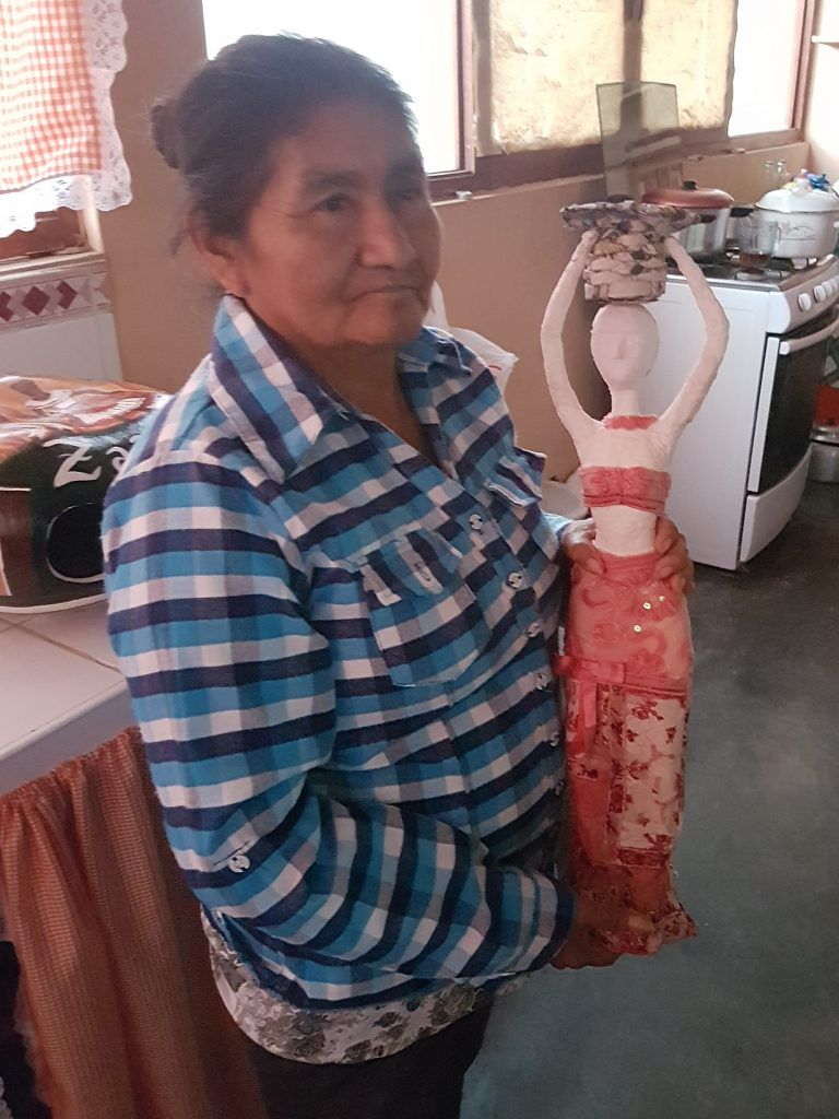 woman holding handmade doll
