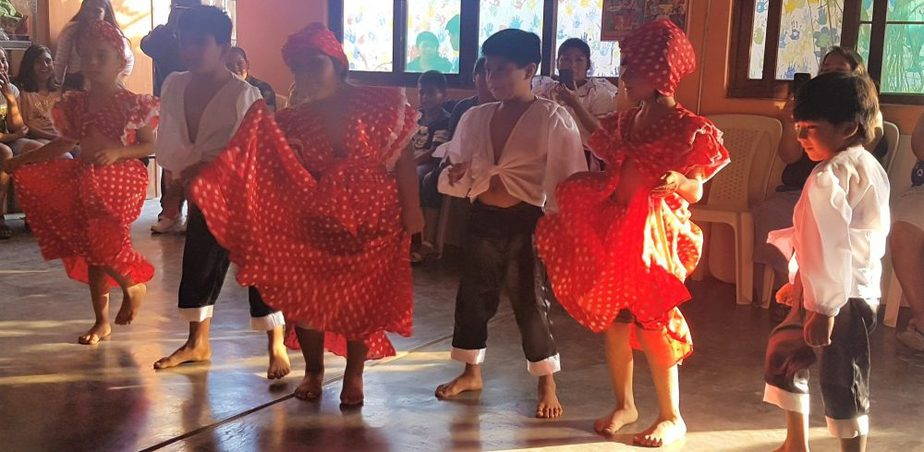 Children dancing in traditional outfits