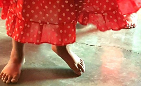 A closeup of a girl's feet, while she dances