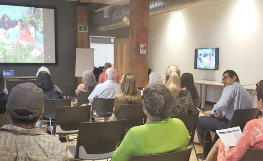 A Canadian audience watches a video about work in Peru
