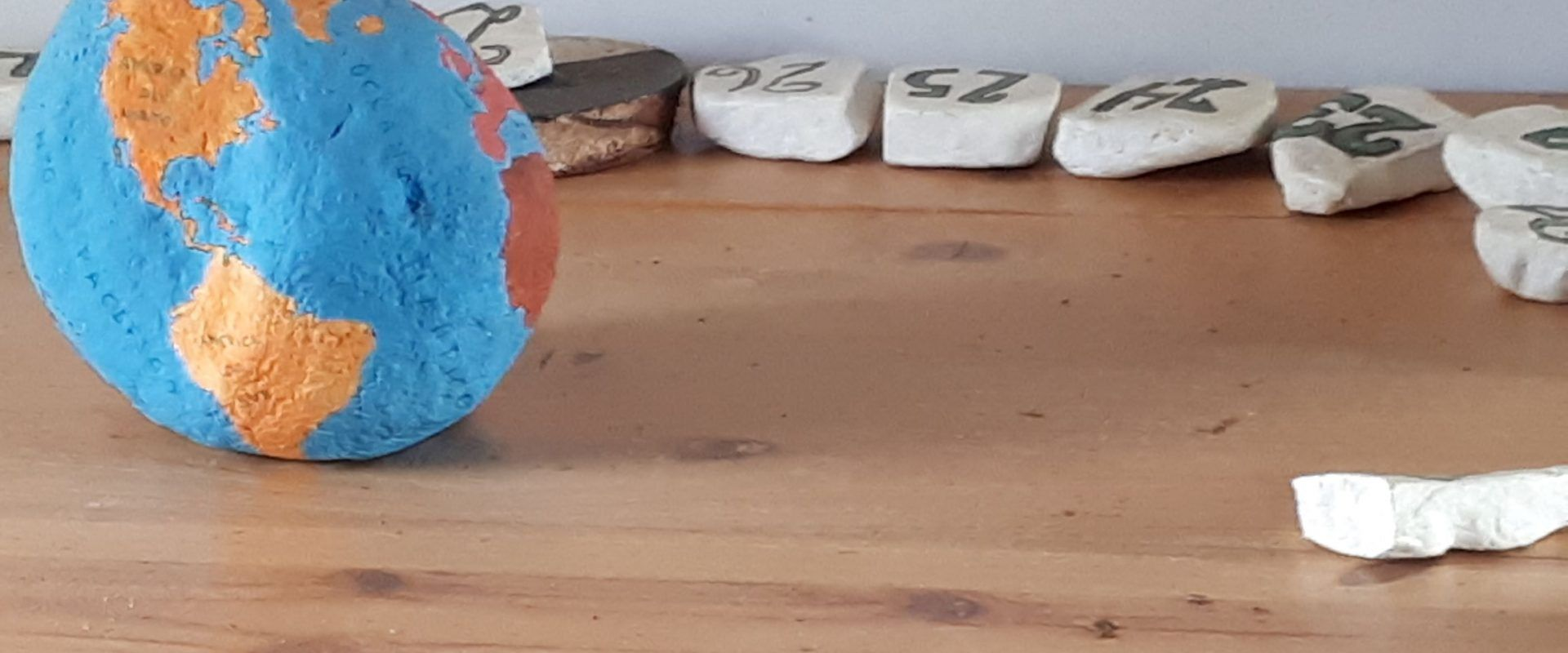 Painted stones with numbers, used as a calendar.