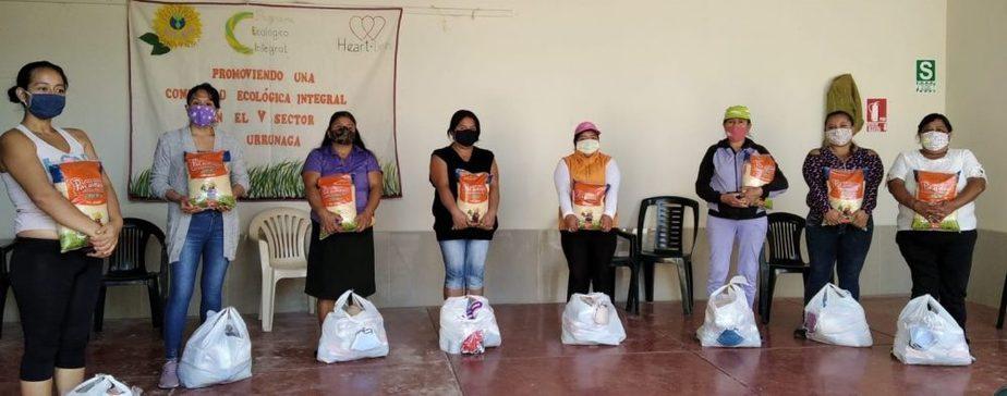 women receiving baskets of food