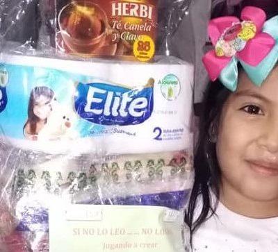 girl hold bag of goodies she won