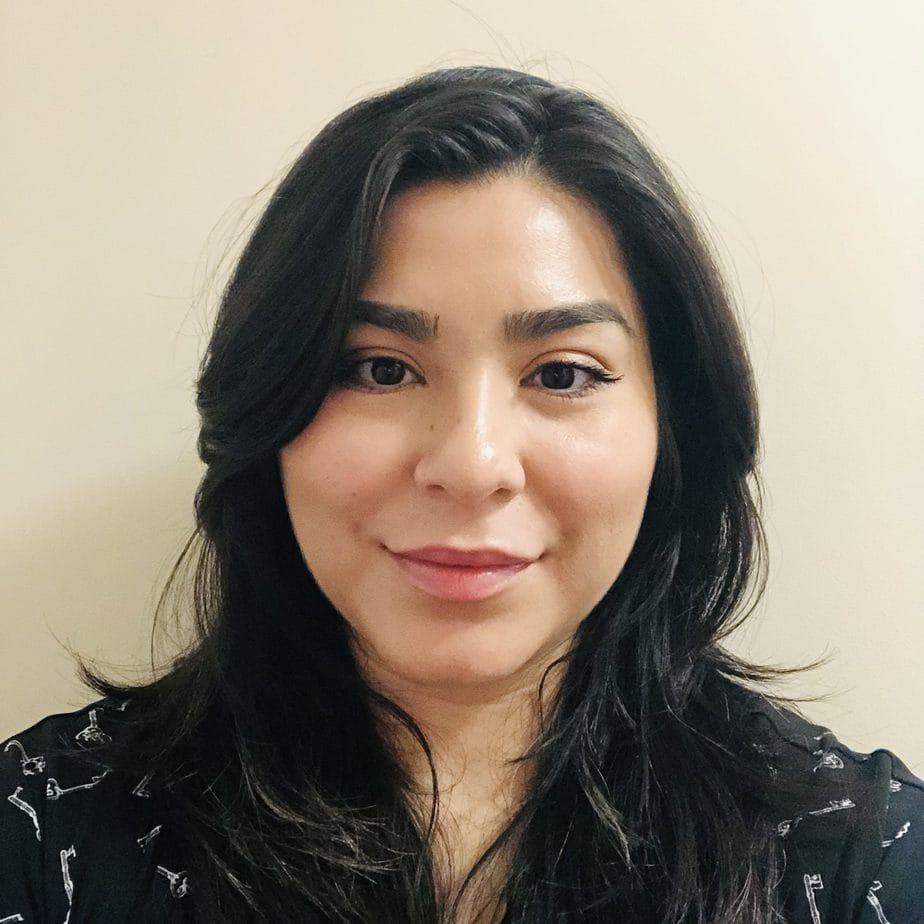 Headshot of Elisa Alvarez.