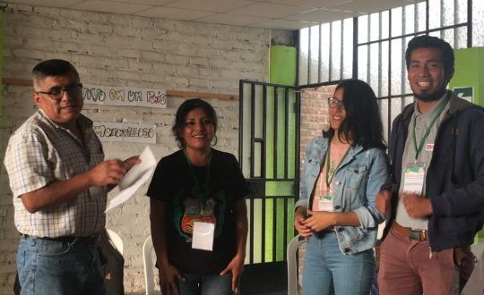 two men and two women talk to workshop participants
