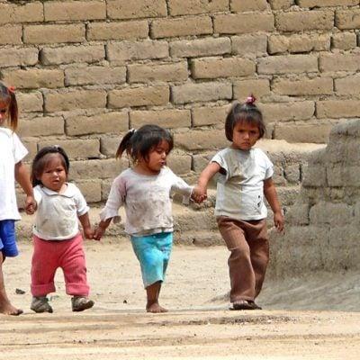 four little girls walking hand in hand
