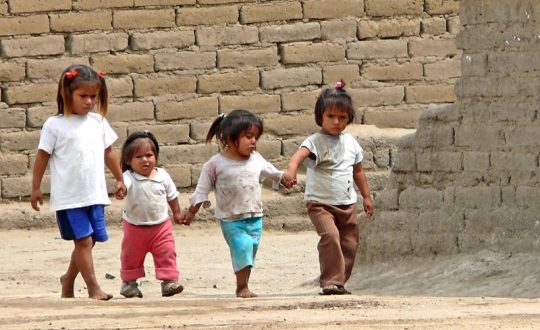four little girls walking hand in hand