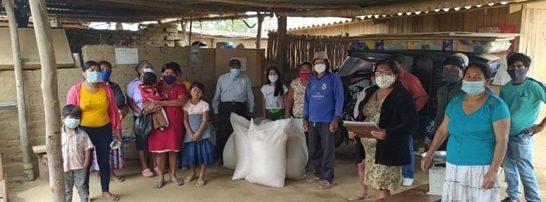 rural community in masks receive grains